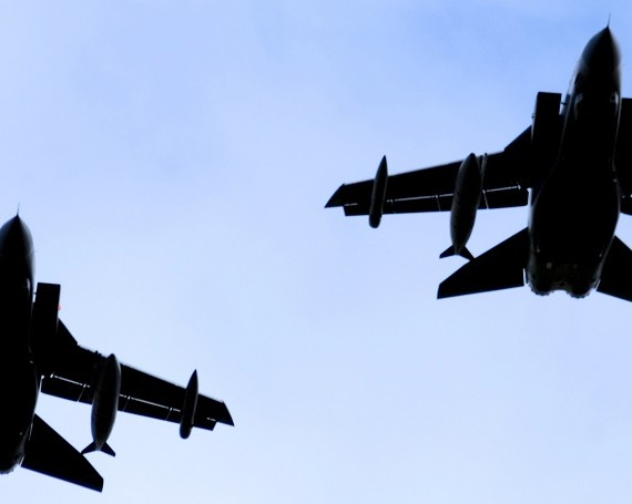 A silhouette of two RAF Tornado jet fighters against a blue sky.