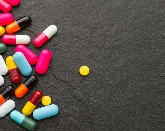 Many pills and tablets on black background for decorate and design project.